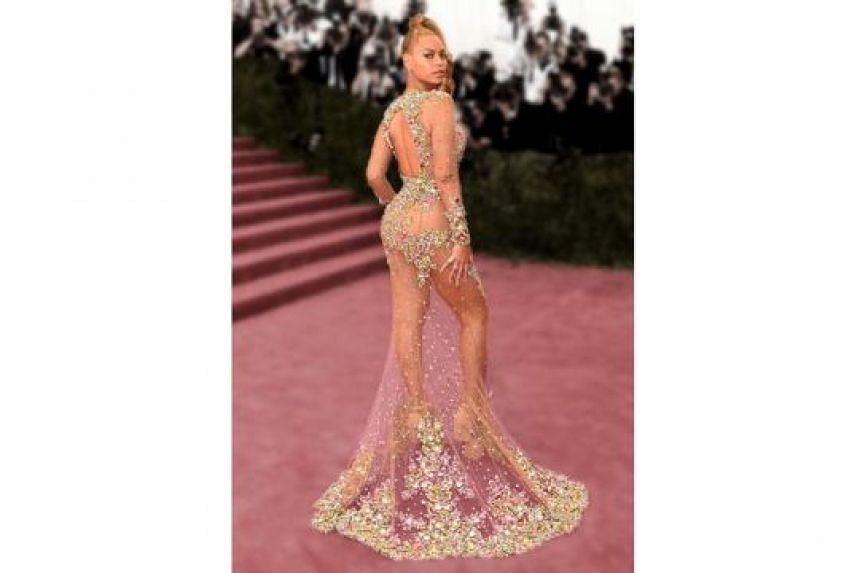 Other celebrities who have made headlines with their outfits include R&B queen Beyonce (above) in Givenchy in 2015, singer-actress Jennifer Lopez in Versace in 2000 and actress Angelina Jolie in Versace in 2012.