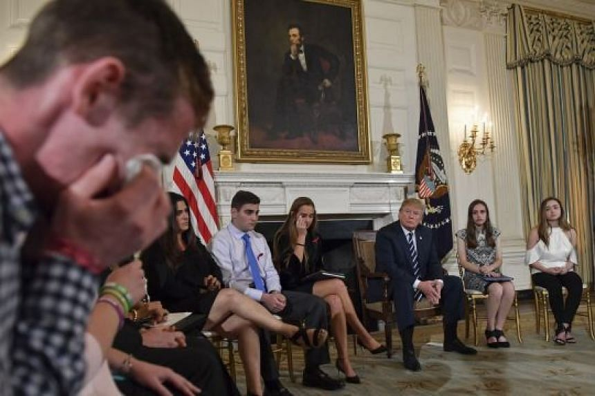 Sam Zeif, a student at Marjory Stoneman Douglas High School, weeping as he recounted his story of the shooting last week as other students, teachers and President Donald Trump listen, at the White House on Wednesday. The teen described texting his fa