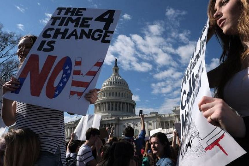 High school students rally against gun violence on Wednesday in front of the Capitol in Washington.