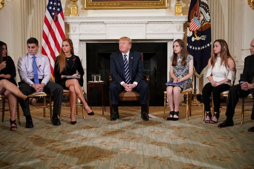 """US President Donald Trump takes part in a """"listening session"""" on gun violence with teachers and students."""