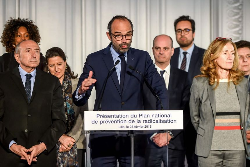 French Prime Minister Edouard Philippe (front row, centre), flanked by ministers, delivers a speech during the presentation of the national plan for the prevention of radicalisation in Lille on Feb 23, 2018.