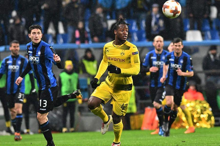 "Borussia Dortmund striker Michy Batshuayi wrote on Twitter that he heard ""monkey noises"" from the Atalanta supporters."