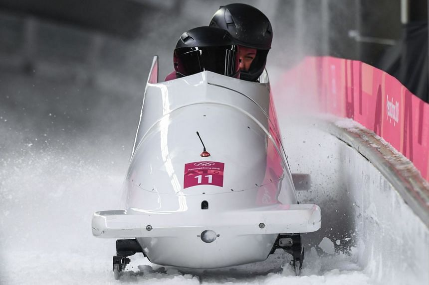 Russia's Nadezhda Sergeeva and Anastasia Kocherzhova compete in the women's bobsleigh heat 3 run during the Pyeongchang 2018 Winter Olympic Games at the Olympic Sliding Centre on Feb 21, 2018.