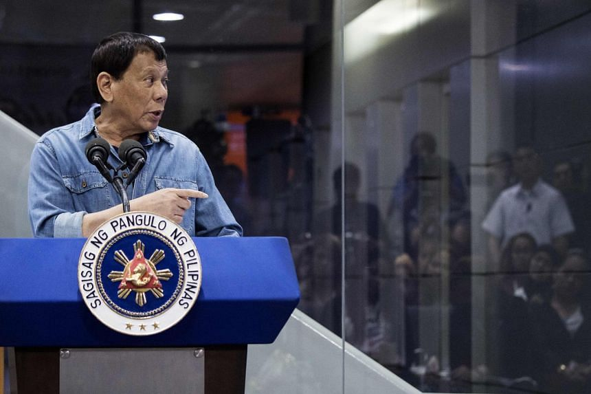 Philippines President Rodrigo Duterte delivers his speech to overseas Filipina workers at the Manila International Airport on Feb 13, 2018.