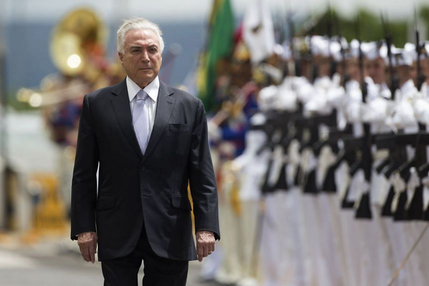 Brazilian President Michel Temer reviews the troops upon his arrival to the meeting of the Military Defense Council in Brasilia on Feb 22, 2018.