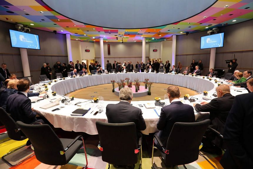 Officials attend a lunch during an informal meeting of the 27 EU heads of state or government in Brussels on Feb 23, 2018.