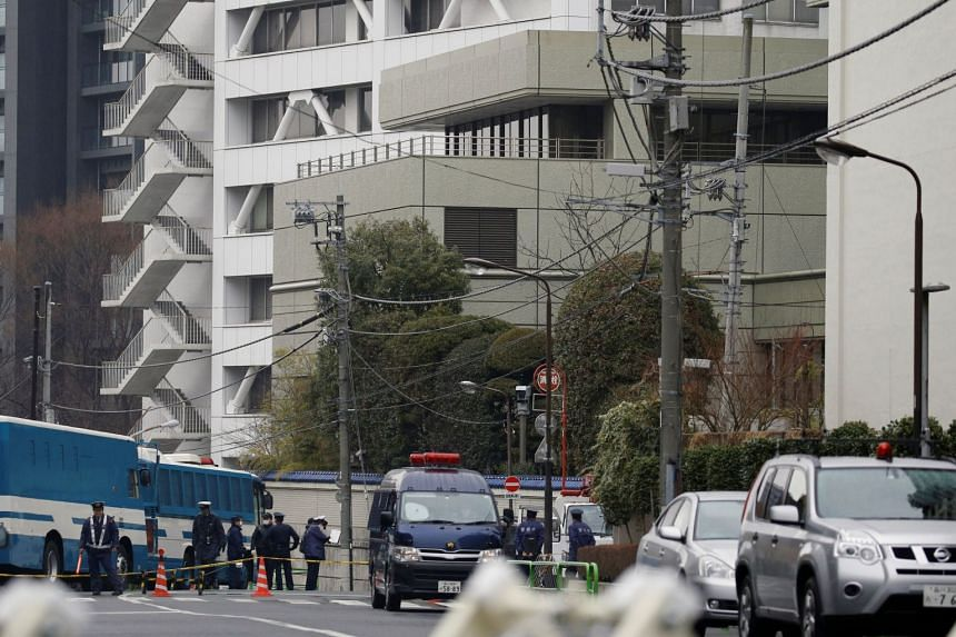 Police officers stand guard near the headquarters of the General Association of Korean Residents in Japan (Chongryon) in Tokyo on Feb 23, 2018, after a shooting took place in the building.