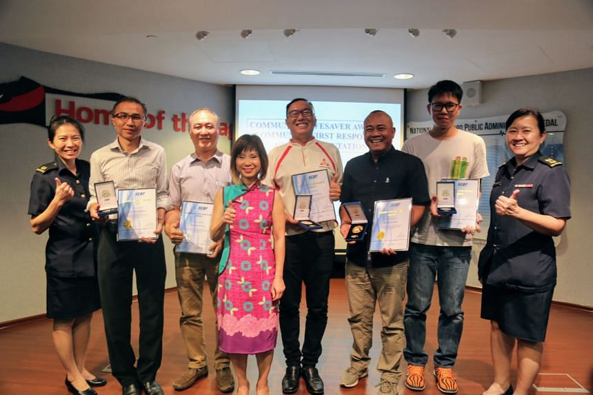 (From left) Major Chia Peng Peng, Mr Chew Ho Kiat Raymond, Mr Wong Kuek Phong, Hong Kah North MP Amy Khor, Mr Ng Kheng Yong Danny, Mr Asnadi Bin Robani, Mr Billy Lim Kuang Lee and Lieutenant Colonel Betty Ting.