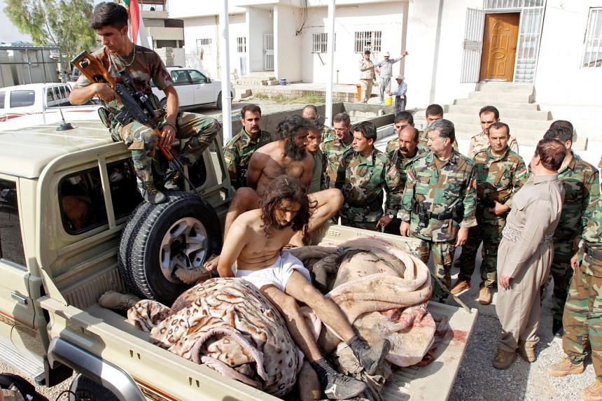 Kurdish Peshmerga forces detain men suspected of being Islamic State militants southwest of Kirkuk, Iraq, on Oct 9, 2017.
