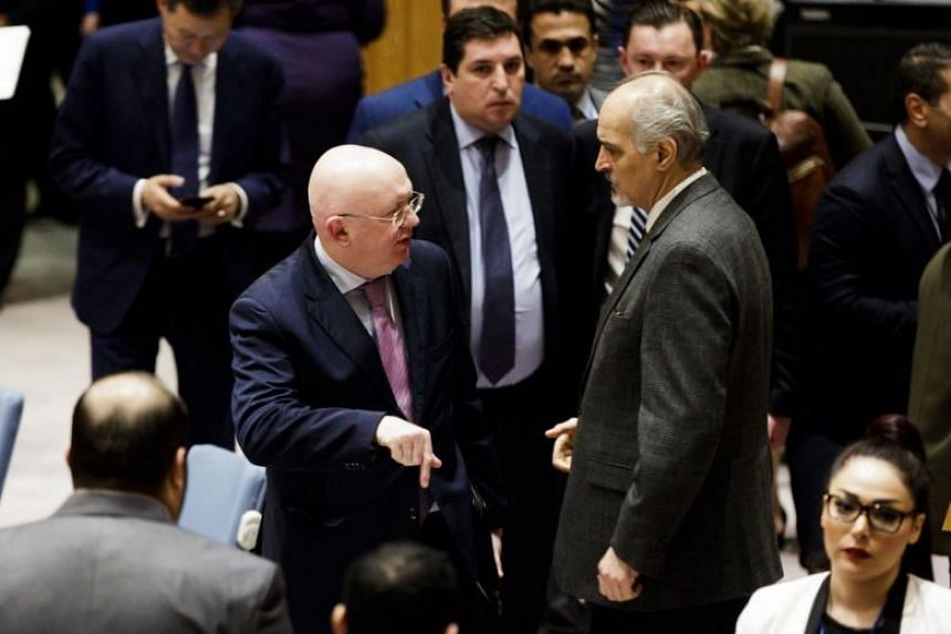 Russian Ambassador to the United Nations (UN) Vassily Nebenzea (left) talks with Syrian Ambassador to the UN Bashar al-Ja'afari after a scheduled vote in the UN Security Council on a draft resolution calling for a 30-day ceasefire was postponed.
