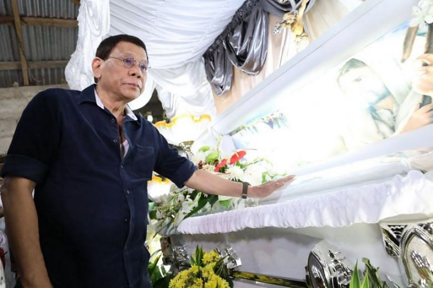 Philippine President Rodrigo Duterte viewing the coffin of Joanna Demafelis on Feb 22, 2018.