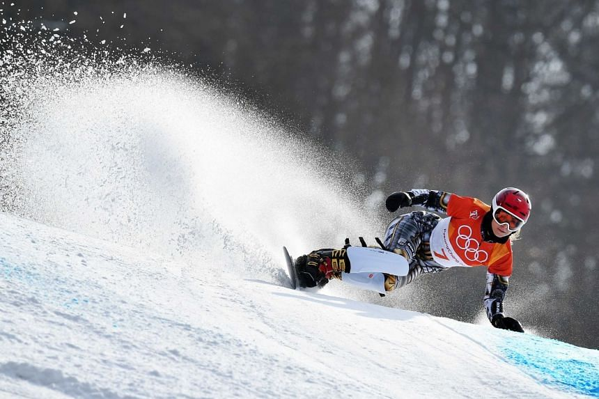 Ester Ledecka added a snowboarding parallel giant slalom gold to add to her shock super-G title in alpine skiing.