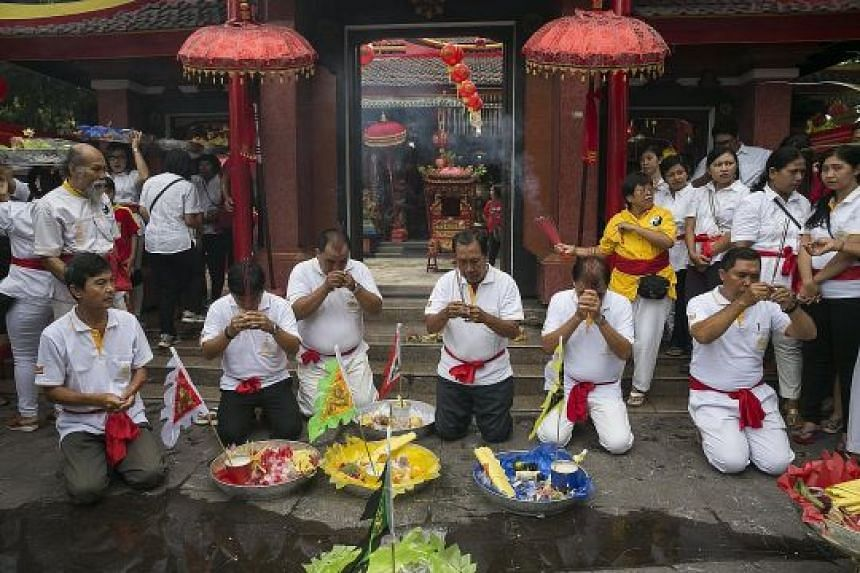 Ethnic Chinese-Indonesians praying during Chinese New Year celebrations at a temple in Bali last week. Years ago, under former president Suharto's policy of assimilation, everything connected to Chinese culture and language was forbidden, and Chinese