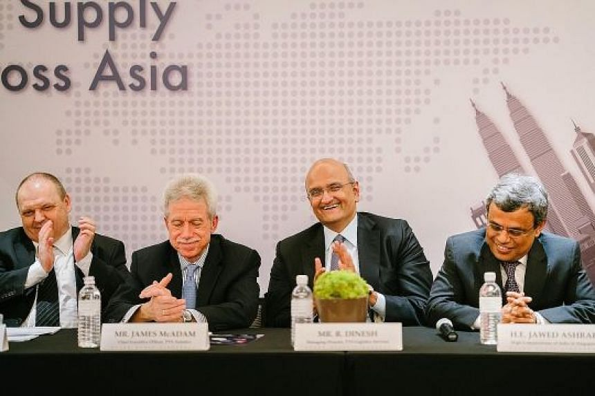 (From left) Pan Asia Logistics founder Christian Bischoff, TVS Asianics chief executive James McAdam, TVS Logistics Services managing director R. Dinesh and India's High Commissioner to Singapore Jawed Ashraf at a media conference. TVS Asianics said