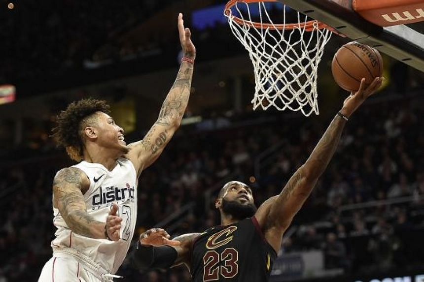 Cleveland forward LeBron James driving to the rim against Washington forward Kelly Oubre Jr at Quicken Loans Arena. Poor three-point shooting was a factor in the Cavaliers' 103-110 loss.