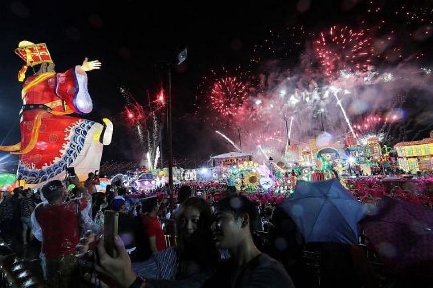 The crowd enjoying the fireworks display during the Chingay finale at River Hongbao last night. In an effort to step up security, the police robot was deployed after 8pm to patrol a 400m stretch at the end point of the parade.