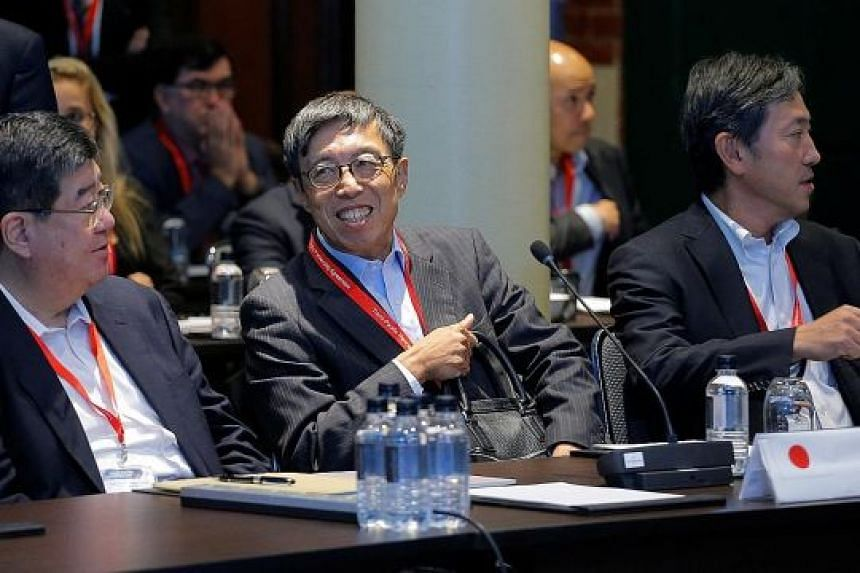 Japan's chief trade negotiator, Mr Kazuyoshi Umemoto (centre), with other Japanese delegates at the TPP senior leaders meeting in Sydney last year. Japan's core plan had always been for TPP, and the Asia-Pacific, to include the US - until President D
