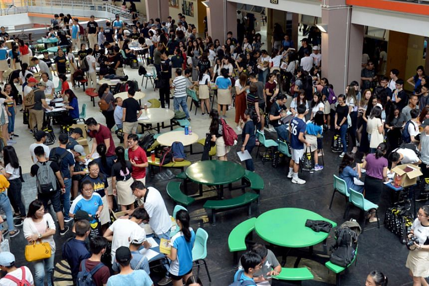 Students getting their A-level result slips in Nanyang Junior College, one of the four schools affected by the theft of exam scripts for Chemistry Paper 3, which carries 35 per cent of the marks for the subject.
