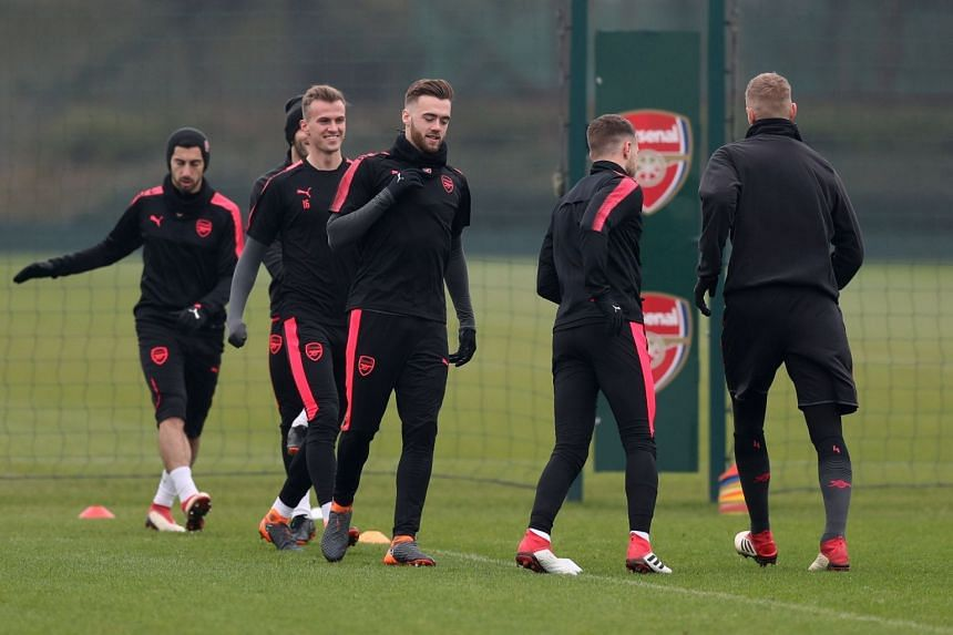 Arsenal's Calum Chambers, Rob Holding and team-mates at a training session.