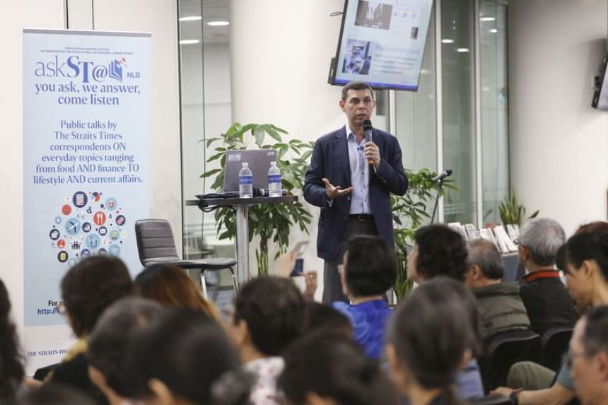 Mr Warren Fernandez, Straits Times editor and Singapore Press Holdings' editor-in-chief for its English/Malay/Tamil Media Group, interacts with the audience at his askST@NLB talk at the National Library on Feb 23, 2018.