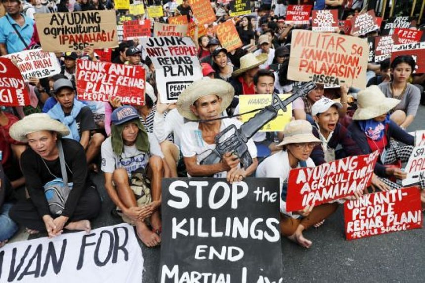Filipino students, and their supporters, at a protest rally following their walkout from classes in Manila yesterday. The students were calling for an end to what they said was President Rodrigo Duterte's rising dictatorship.