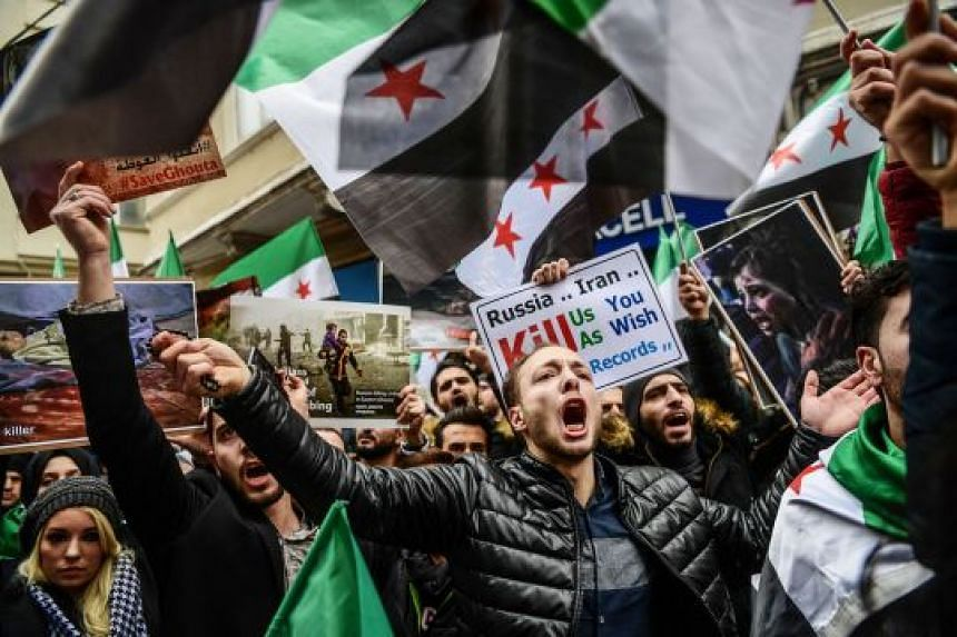 Protesters in front of the Russian consulate in Istanbul on Thursday during a demonstration against the air strikes and shelling by Syrian government forces in Ghouta. The writer says the external powers which had earlier been entrusted with the resp