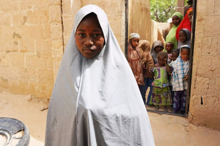Hassana Mohammed, 13, scaled a fence to escape the alleged Boko Haram attack.