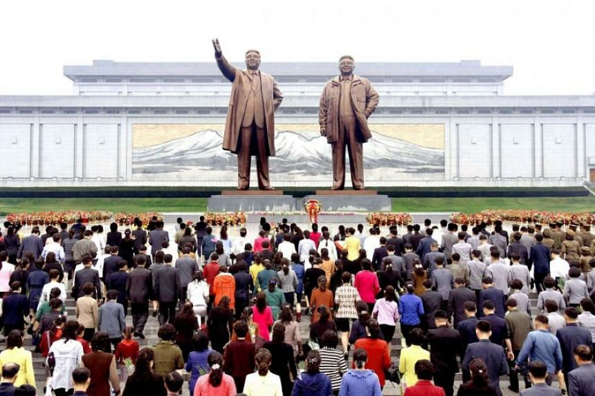 Floral tributes are paid to the statues of North Korea founder Kim Il Sung and late leader Kim Jong Il on the 72nd founding anniversary of the Workers' Party of Korea in Pyongyang.