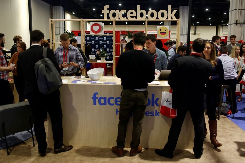 People stopping at the Facebook booth at the Conservative Political Action Conference (CPAC) at National Harbor, Maryland, US, on Feb 23, 2018.