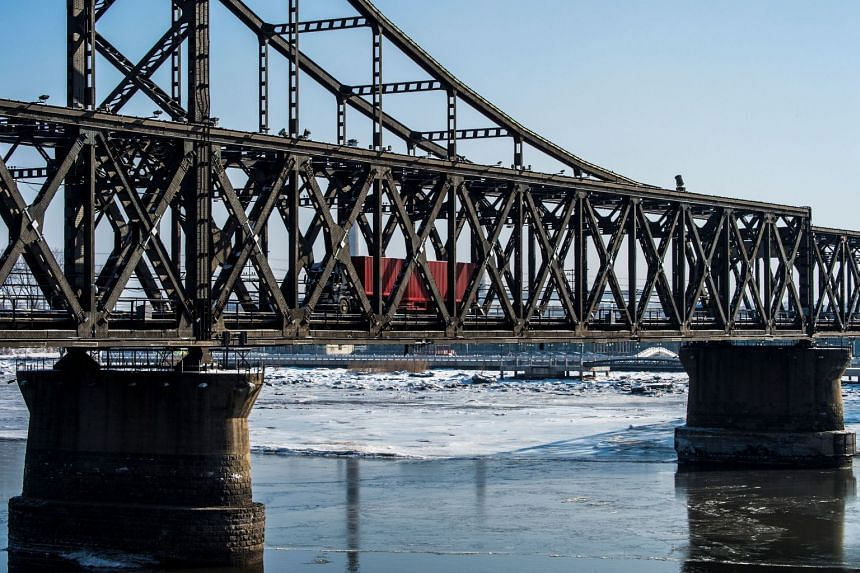 A truck returns over the Friendship Bridge from the North Korean town of Sinuiju to the Chinese border city of Dandong on Jan 9, 2018.