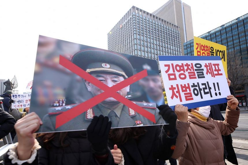 Protesters including the bereaved families of the 46 crewmen killed in the 2010 sinking of the Cheonan warship stage a rally in Seoul on Feb 24, 2018, to oppose the planned visit to South Korea by a North Korean general.