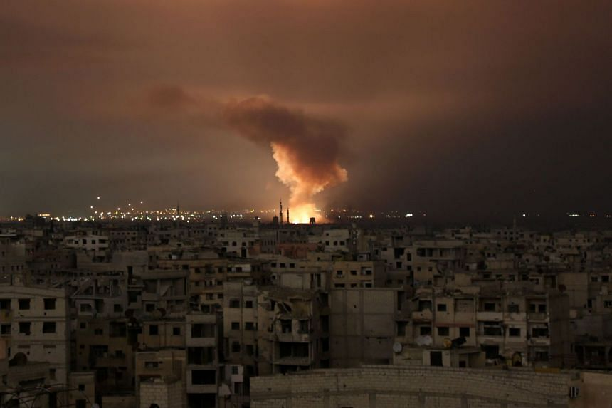 Smoke billows following a regime air strike on the Syrian rebel enclave of Eastern Ghouta on Feb 23, 2018.