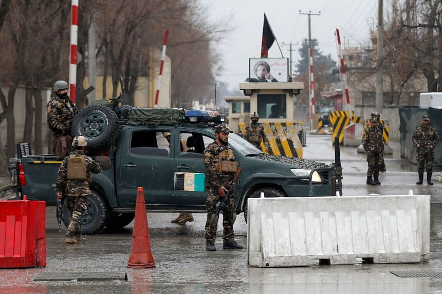 Afghan security forces keep watch at a checkpoint near the site of a suicide attack in Kabul on Feb 24, 2018.