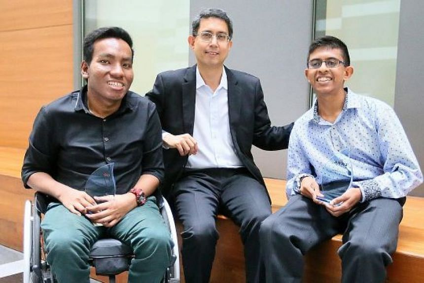 (From left) Mr Noor Iskandaria Mohd Dena, Associate Professor Muhammad Faisal Ibrahim and Mr Pranav C. Balu at the Lifelong Learning Institute. Mr Iskandaria and Mr Pranav both received awards yesterday.