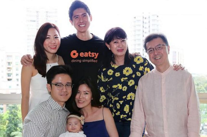 Mr Shaun Heng (in black shirt) with (from left) his girlfriend Lim Kai Chian, brother-in-law Ng Hong Kin, niece Alexa, sister Charmaine Heng, mother Jane Heng and father Paul Heng. Mr Shaun Heng said his parents always taught the family to give back