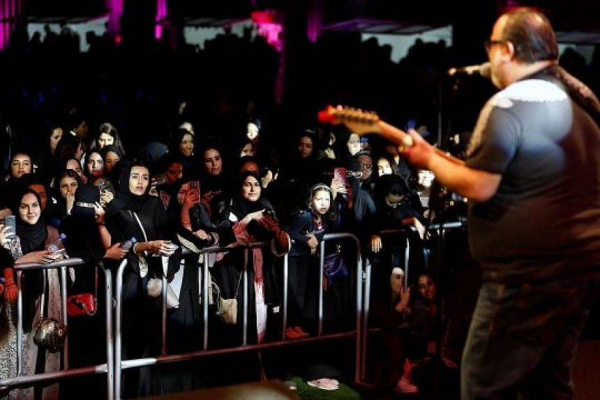Women and children at Saudi Arabia's first jazz festival in Riyadh on Friday. Despite the persisting restrictions - men and women were still confined to different sections apart from family areas - the three-day music festival marks a change in socia