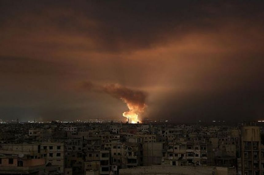Smoke billowing from the site of an air strike in the besieged Eastern Ghouta region on the outskirts of the Syrian capital Damascus late on Friday. Syrian regime air strikes and artillery fire continue to rain down on the rebel-held enclave, where s
