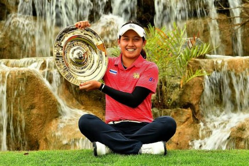 Thai teenager Atthaya Thitikul showing off her trophy after winning the Women's Amateur Asia-Pacific c'ship following a four-way play-off at Sentosa Golf Club's New Tanjong Course yesterday.