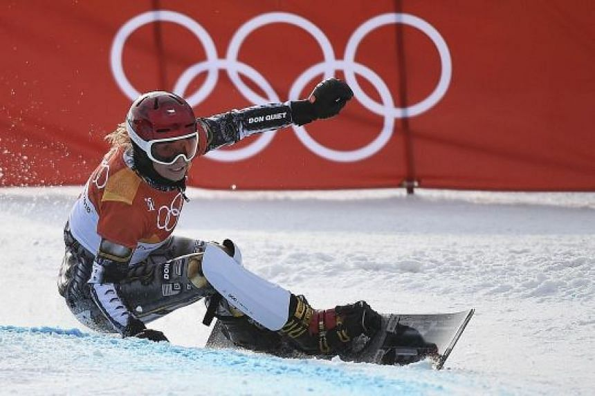 Ester Ledecka of the Czech Republic on her way to winning the women's snowboard parallel giant slalom yesterday. She also took gold in the skiing super-G last week.