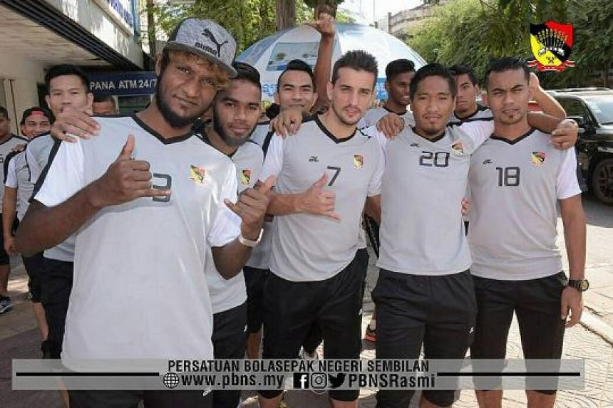 """Madhu Mohana (in cap) with Negeri team-mates while on a training tour in pre-season. He says the club cited a """"long-term"""" groin injury for ending his contract."""