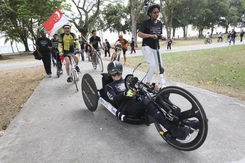 Dr William Tan handcycled for 31 hours from East Coast Park to Serangoon Junior College to mark the 31st anniversary and raise funds for Bizlink Centre, a charity that serves people with disabilities.