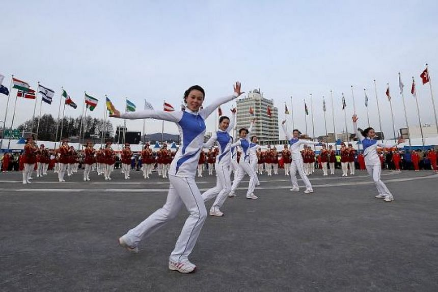 North Korean cheerleaders performing before the medals ceremony at the Olympic Plaza in Pyeongchang on Tuesday. Defectors claim that behind the bright smiles lie stories of suffering and abuse.
