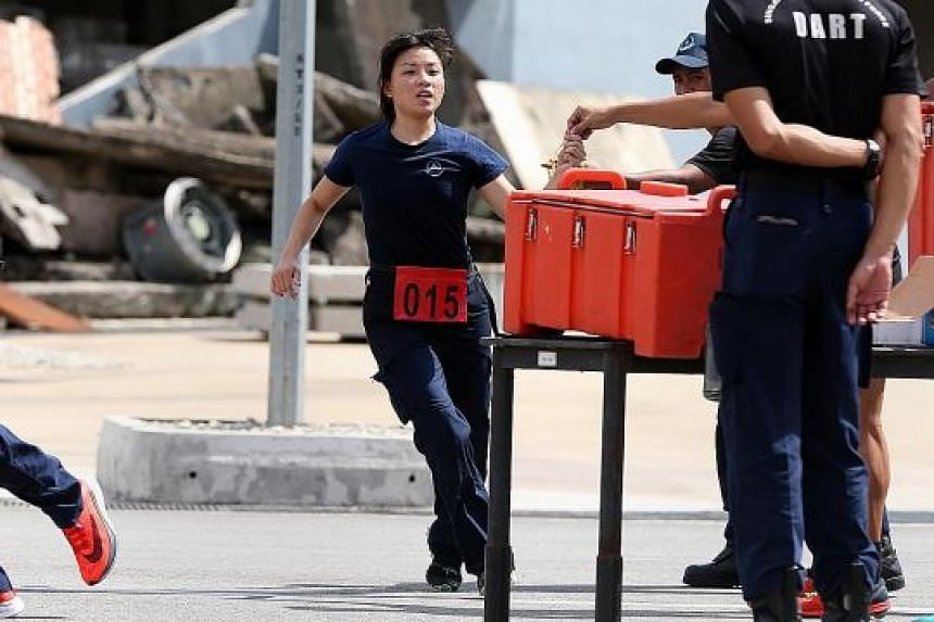 Lieutenant Gan Chea Hui in action during the SCDF's Disaster Assistance and Rescue Team selection this month.