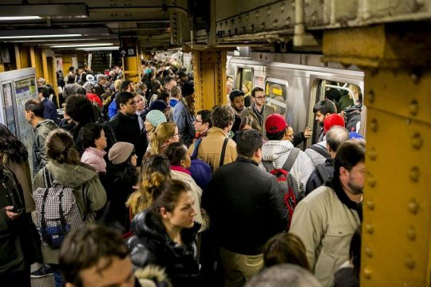 A crowded subway platform at Union Square in Manhattan. A significant number of delays on the transit system are officially attributed to overcrowding, with New York City now far bigger than it was a century ago.