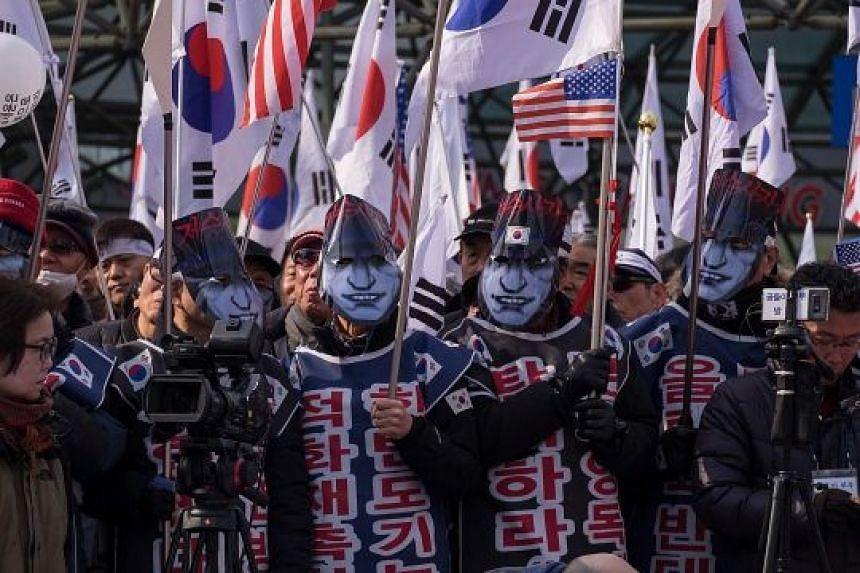 Angry relatives of sailors killed in the 2010 sinking of a South Korean warship protesting against the impending visit to the Winter Olympics of a North Korean general blamed for the attack.