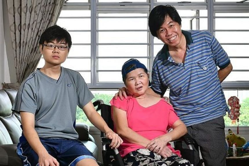 DECEMBER 2016: The family was overjoyed when Madam Ang was well enough to be discharged from hospital. She is seen here with her son Dominic and husband Leong Loon Wah.