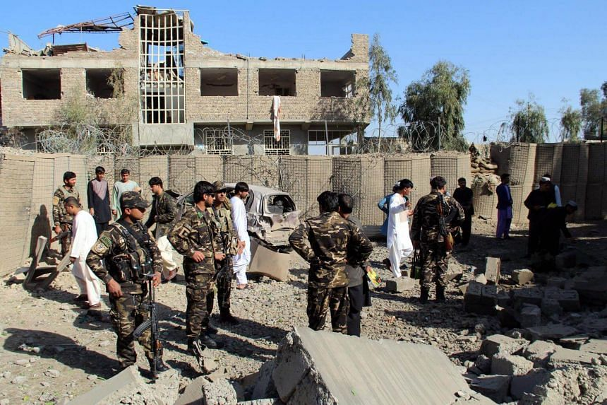 Afghan security officials inspect the scene of a suicide bomb attack that targeted the office of National Directorate of Security in Afghanistan on Feb 24, 2018.