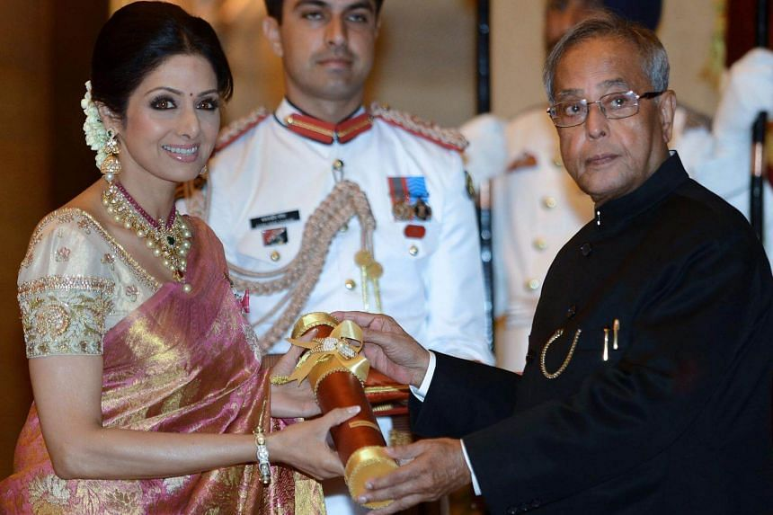 A file photo showing then-Indian President Pranab Mukherjee presenting the Padma Shree award to Indian film actress Sridevi during the presentation of the Padma Awards 2013 at the Presidential Palace in New Delhi, on April 5, 2013.