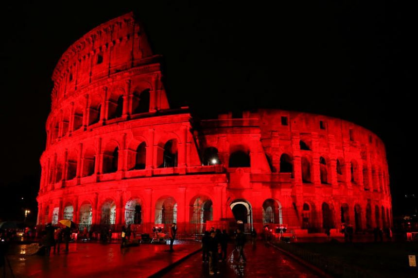 The Colosseum is lit up in red to draw attention to the persecution of Christians around the world in Rome, Italy, on Feb 24, 2018.