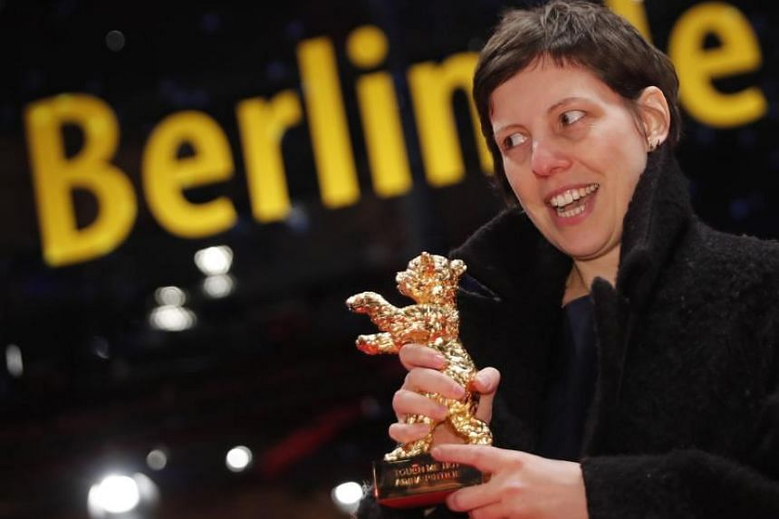 Director, screenwriter, editor and producer Adina Pintilie poses with her Golden Bear award for Best Film Touch Me Not during the awards ceremony at the 68th Berlinale International Film Festival in Berlin, Germany, on Feb 24, 2018.
